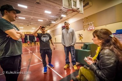 Karli Zschogner interviewing East Coast Music Award winners City Natives when performing at performed at L'nu Sipuk Kina'muokuom (LSK School) in Indian Brook First Nation, N.S. on May 2, 2018 (Credit: Stephen Brake)